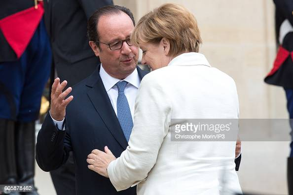 French President Francois Hollande receives German Federal Chancellor Angela Merkel for a meeting followed by a working lunch in connection with the...