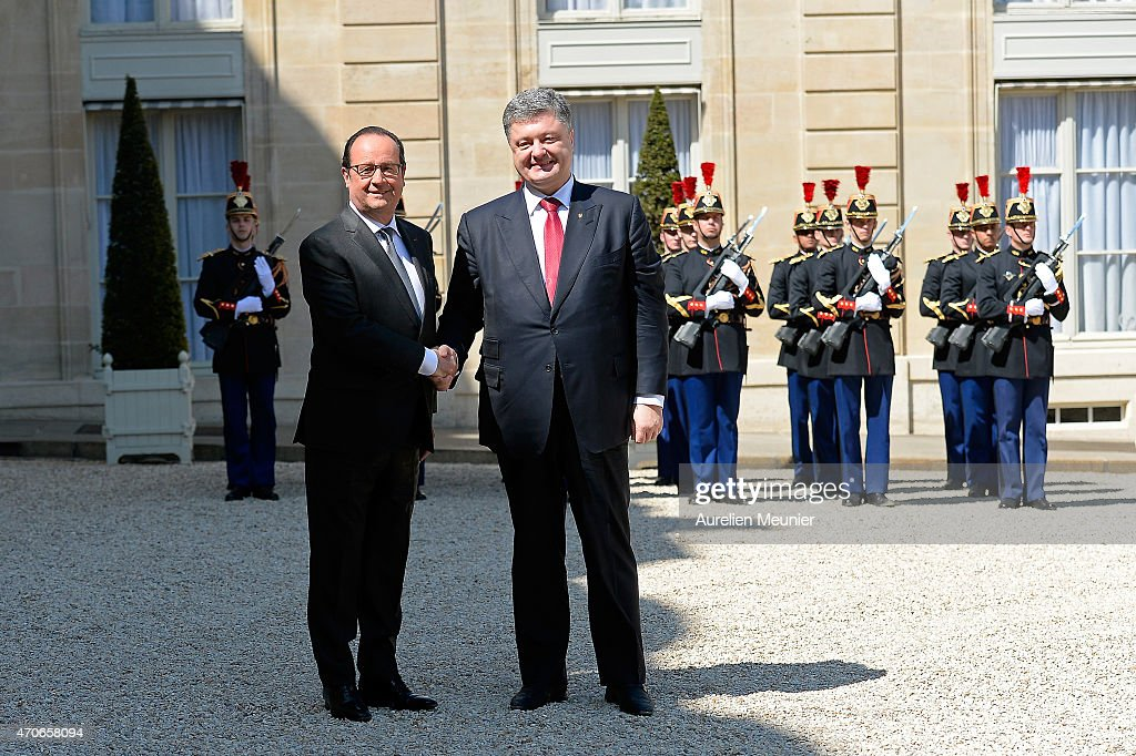 French President Francois Hollande (L) receives President of Ukraine Petro Porochenko (R) for a meeting followed by a lunch at Elysee Palace on April 22, 2015 in Paris, France. They will speak about the war situation in Ukraine.