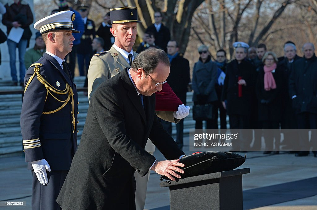 French President Francois Hollande remits the Legion of Honnor to the Unknown Soldier at Arlington National Cemetery in Virginia on February 11 2014...