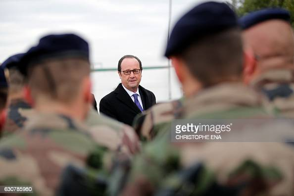 French President Francois Hollande reviews French soldiers at the Iraqi Counter Terrorism Service Academy at the Baghdad Airport Complex in Baghdad...