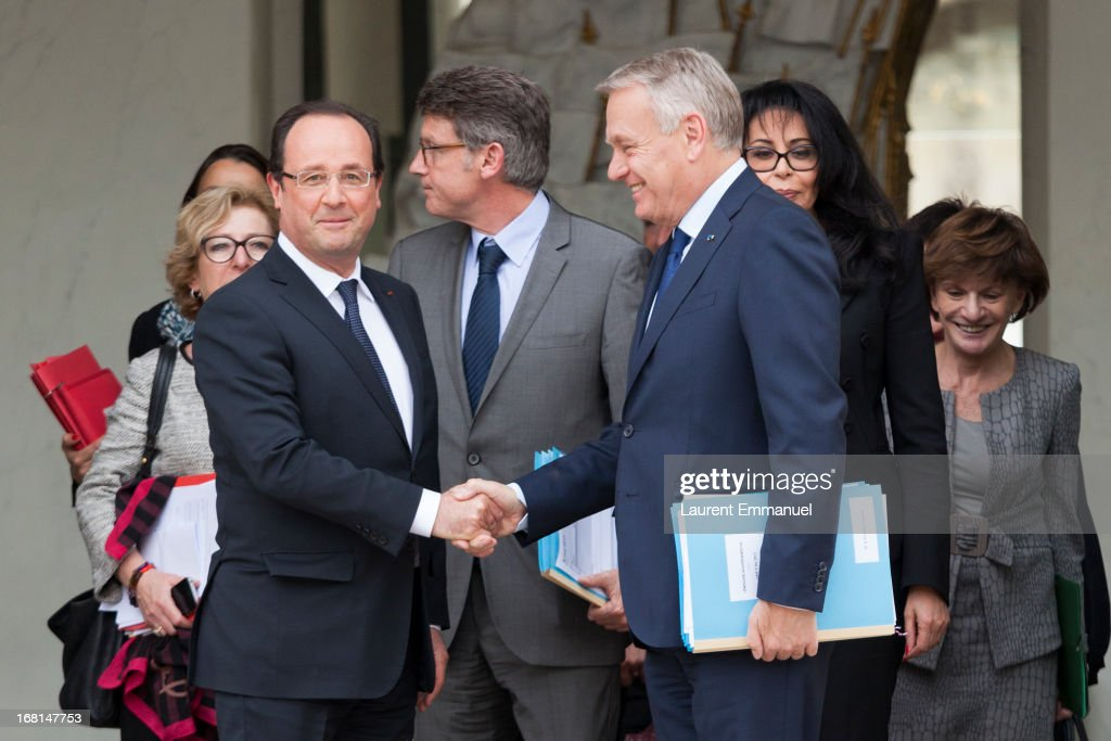 French President Francois Hollande (L) shakes hand with French Prime Minister <a gi-track='captionPersonalityLinkClicked' href=/galleries/search?phrase=Jean-Marc+Ayrault&family=editorial&specificpeople=551961 ng-click='$event.stopPropagation()'>Jean-Marc Ayrault</a> (R) following a meeting of government ministers presided by Hollande at Elysee Palace on May 6, 2013 in Paris, France.