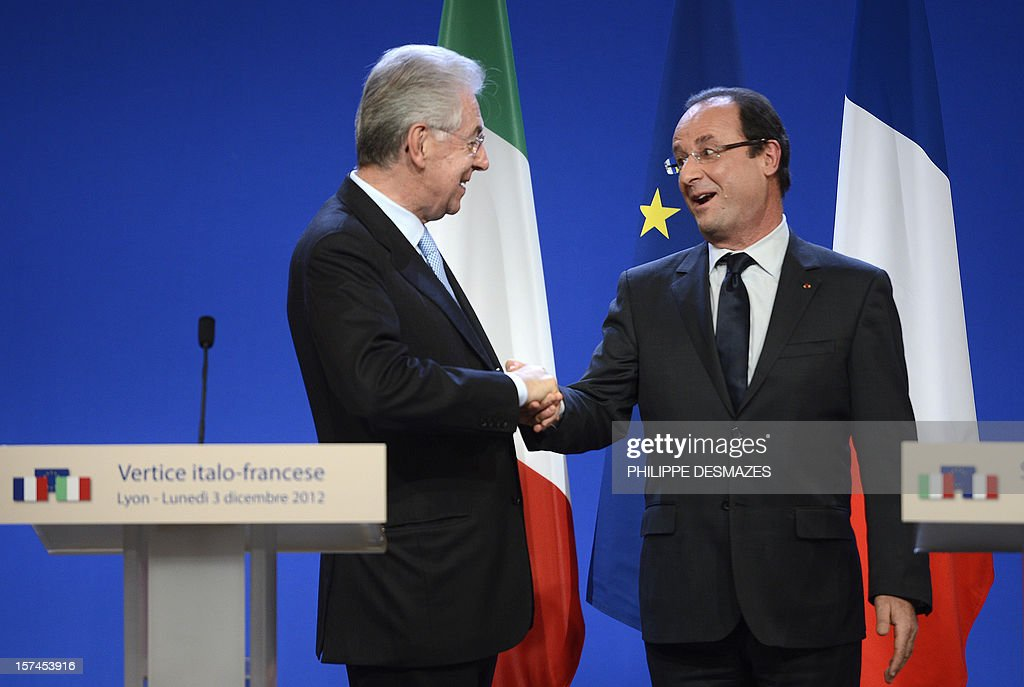 French President Francois Hollande (R) shakes hand with Italian Prime Minister Mario Monti on December 3, 2012 at the end of a press coference during the 30th France-Italy annual summit in the central French city of Lyon. DESMAZES