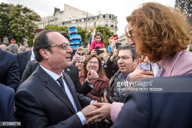 French President Francois Hollande shakes hands with a French Armenian during a ceremony marking the 102nd anniversary of the Armenian genocide in...
