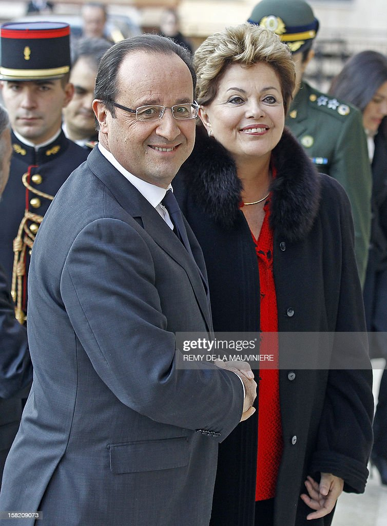French President Francois Hollande (L) shakes hands with Brazil's president Dilma Rousseff prior to inaugurate the Forum of Social Progress on December 11, 2012 in Paris. Dilma Rousseff is on a two-day official visit toFrance.