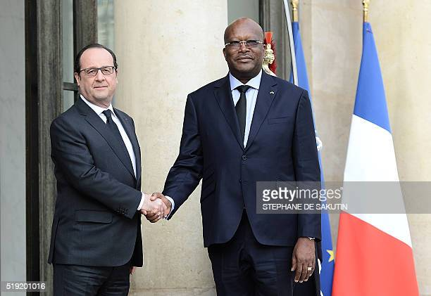 French President Francois Hollande shakes hands with Burkina Faso's President Roch Marc Christian Kabore upon his arrival on April 5 2016 at the...