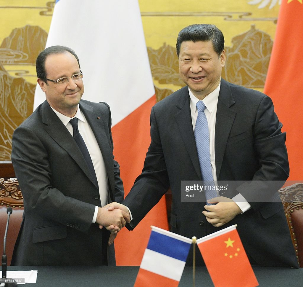 French President Francois Hollande (L) shakes hands with Chinese President <a gi-track='captionPersonalityLinkClicked' href=/galleries/search?phrase=Xi+Jinping&family=editorial&specificpeople=2598986 ng-click='$event.stopPropagation()'>Xi Jinping</a> during a signing ceremony at the Great Hall of the People on April 25, 2013 in Beijing, China. Hollande has begun a two day trade visit to China bringing with him a large French trade delegation.