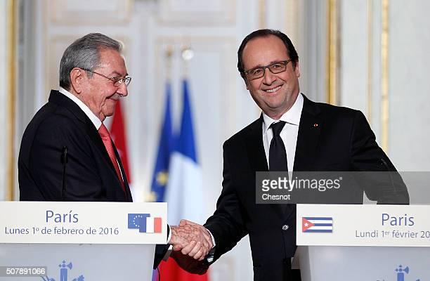 French President Francois Hollande shakes hands with Cuban President Raul Castro after a press conference at the Elysee Presidential Palace on...