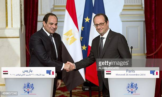 French president Francois Hollande shakes hands with Egyptian President Abdel Fattah alSisi after a joint statement at the Elysee palace on November...