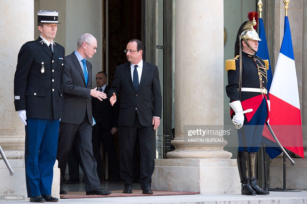French President Francois Hollande (C) shakes hands with EU Council President Herman Van Rompuy (L) after a lunch at the Elysee Palace on April 18, 2013 in Paris.