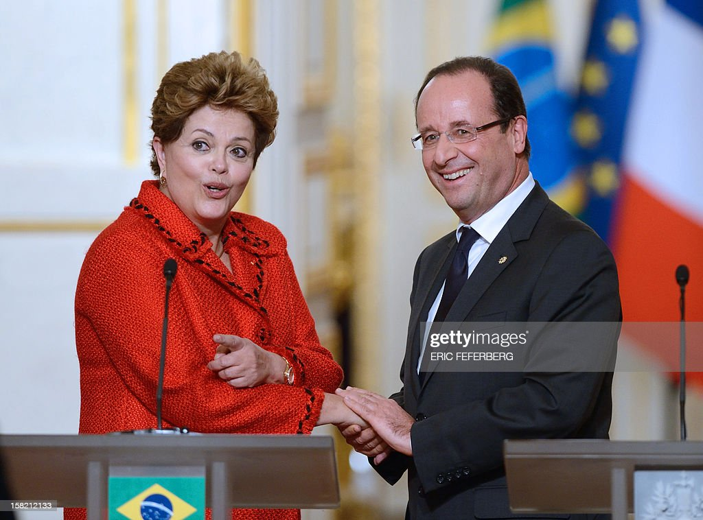 French President Francois Hollande (R) shakes hands with his Brazilian counterpart Dilma Rousseff, on December 11, 2012, at the end of a joint press conference at the Elysee presidential palace in Paris. Brazilian President Dilma Rousseff kicked off her first official visit to France, where a decision on whether she will choose Rafale fighter jets or opt for another aircraft is keenly awaited. During the two-day trip Rousseff will have talks with French counterpart Francois Hollande on the eurozone crisis -- on which she has criticized EU austerity measures -- bilateral trade and wider matters of global concern.