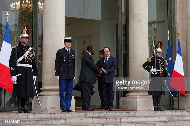 French President Francois Hollande shakes hands with his Ivory Coast counterpart Alassane Ouattara following their meeting at the Elysee Palace on...