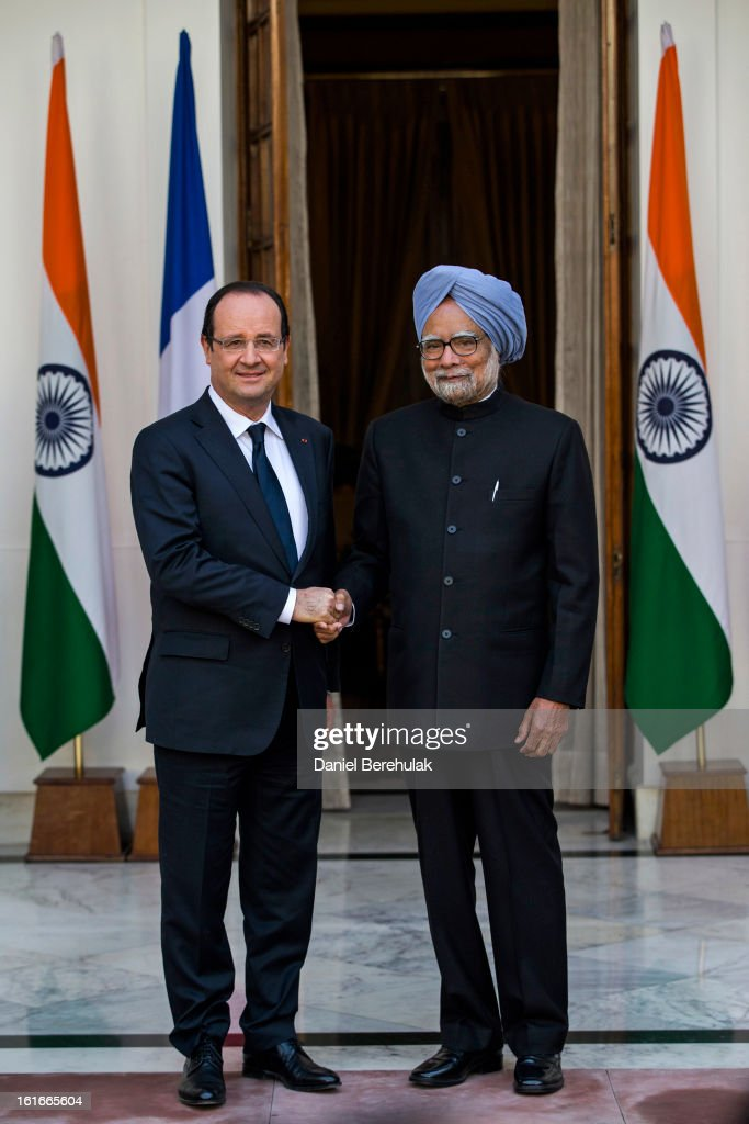 French President Francois Hollande shakes hands with Indian Prime Minister <a gi-track='captionPersonalityLinkClicked' href=/galleries/search?phrase=Manmohan+Singh&family=editorial&specificpeople=227120 ng-click='$event.stopPropagation()'>Manmohan Singh</a> at Hyderabad House on February 14, 2013 in New Delhi, India. French President Francois Hollande arrived in India on Thursday for a two-day trip, his first to Asia since becoming President last year and hopes to build the way for important trade contracts.
