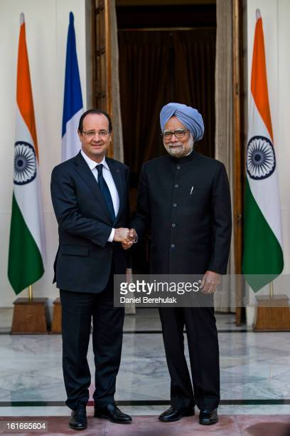 French President Francois Hollande shakes hands with Indian Prime Minister Manmohan Singh at Hyderabad House on February 14 2013 in New Delhi India...
