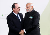 French President Francois Hollande shakes hands with Indian Prime Minister Narendra Modi as he arrives for the COP21 United Nations Climate Change...