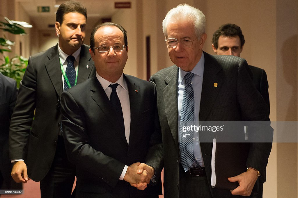 French President Francois Hollande (L) shakes hands with Italian Prime Minister Mario Monti after a bilateral meeting at the EU Headquarters, on November 23, 2012 in Brussels, as part of a two-day European Union leaders summit called to agree a hotly-contested trillion-euro budget through 2020. European leaders voiced pessimism on reaching a deal on a trillion-euro EU bdget, as gruelling talks pushed into a second day with little prospect of bridging bitter divisions. POOL