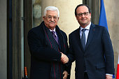French President Francois Hollande shakes hands with Palestinian president Mahmoud Abbas before their meeting at Elysee Palace on April 15 2016 in...