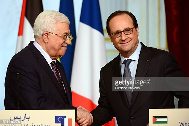 French President Francois Hollande shakes hands with Palestinian president Mahmoud Abbas after the press conference at Elysee Palace on April 15 2016...