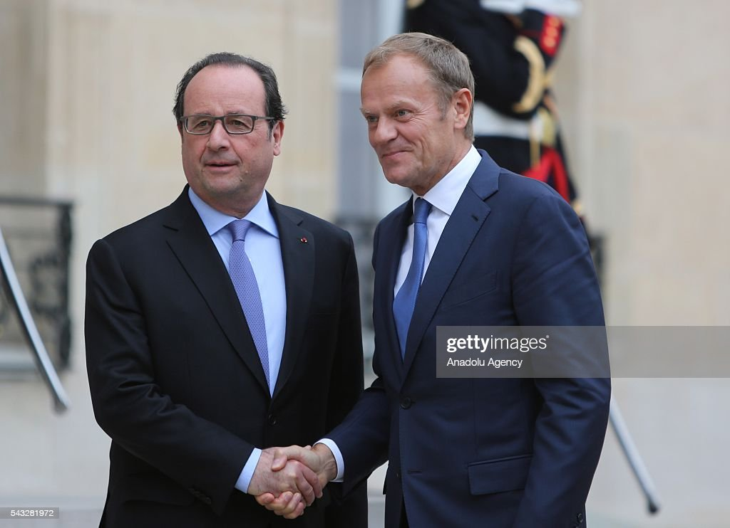 French President Francois Hollande (L) shakes hands with President of the European Council Donald Tusk (not seen) at the Elysee Palace in Paris, France on June 27, 2016.