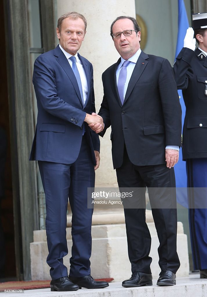 French President Francois Hollande (R) shakes hands with President of the European Council Donald Tusk (not seen) at the Elysee Palace in Paris, France on June 27, 2016.
