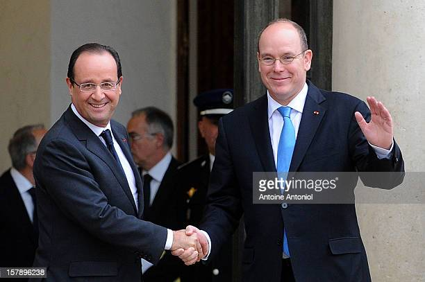French President Francois Hollande shakes hands with Prince Albert II of Monaco at Elysee Palace on December 7 2012 in Paris France