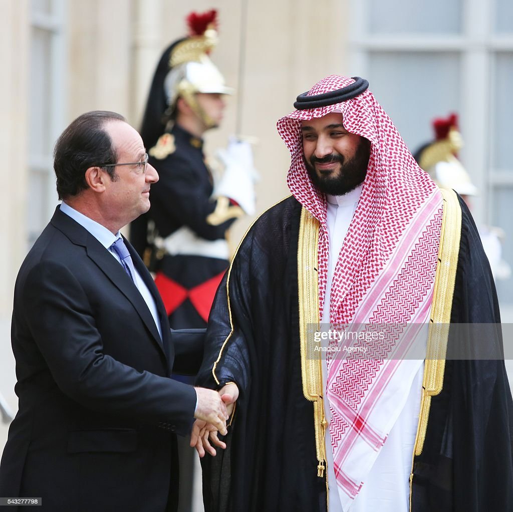 French President Francois Hollande (L) shakes hands with Saudi Defense Minister Mohammad Bin Salman Al Saud at the Elysee Palace in Paris, France on June 27, 2016.