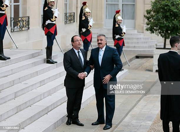 French President Francois Hollande shakes hands with Saudi Prince Mutaib bin Abdullah al Saud at the Elysee Presidential Palace on June 19 2013 in...