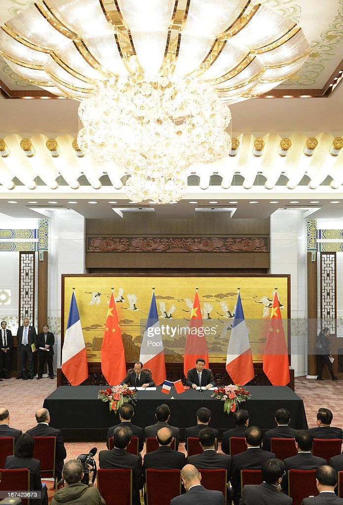 French President Francois Hollande (L) sits alongside Chinese president <a gi-track='captionPersonalityLinkClicked' href=/galleries/search?phrase=Xi+Jinping&family=editorial&specificpeople=2598986 ng-click='$event.stopPropagation()'>Xi Jinping</a> during a signing ceremony at the Great Hall of the People on April 25, 2013 in Beijing, China. Hollande has begun a two day trade visit to China bringing with him a large French trade delegation.