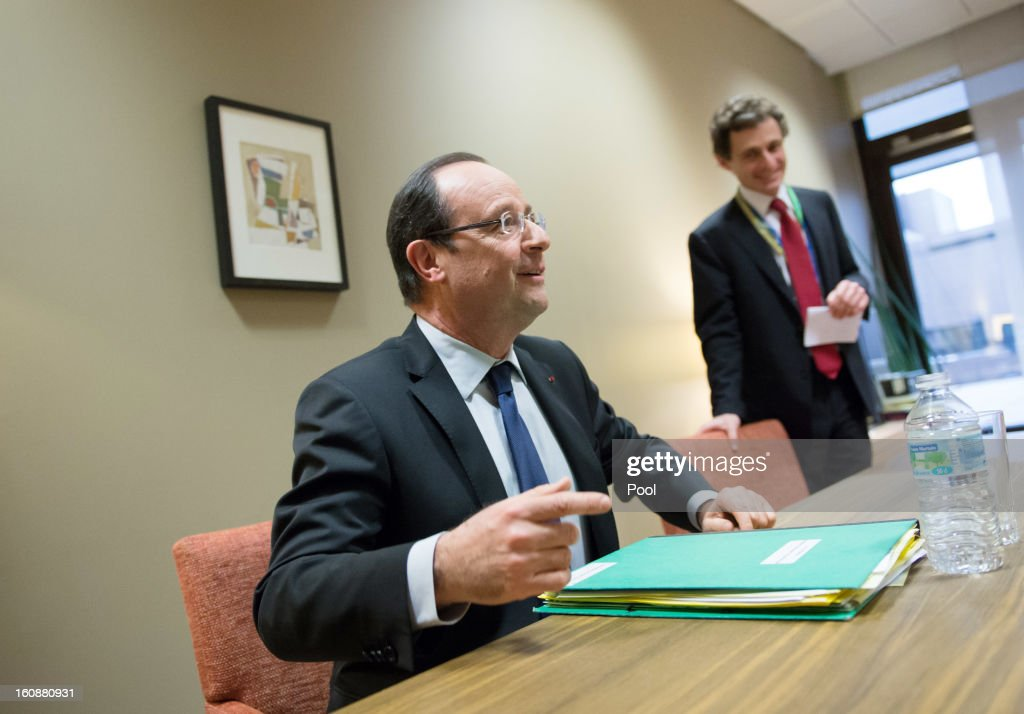 French President Francois Hollande (L) sits during a meeting at the EU Headquarters on the first day of a two-day European Union leaders summit on February 7, 2013 in Brussels, Belgium, European Union leaders are set to duscuss the EU's budget.