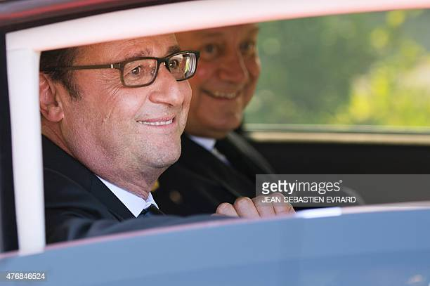 French President Francois Hollande sits in a car as he leaves after the inauguration of the 'Cite de l'Objet Connecte' in SaintSylvaind'Anjoy near...