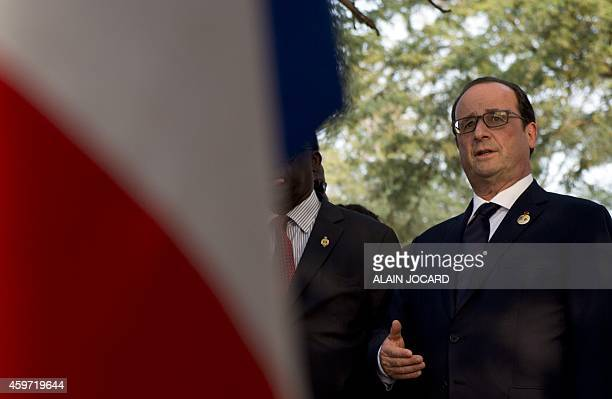 French President Francois Hollande speaks after laying a wreath on the former Senegalese President Leopold Sedar Senghor's grave at Bel air cemetary...