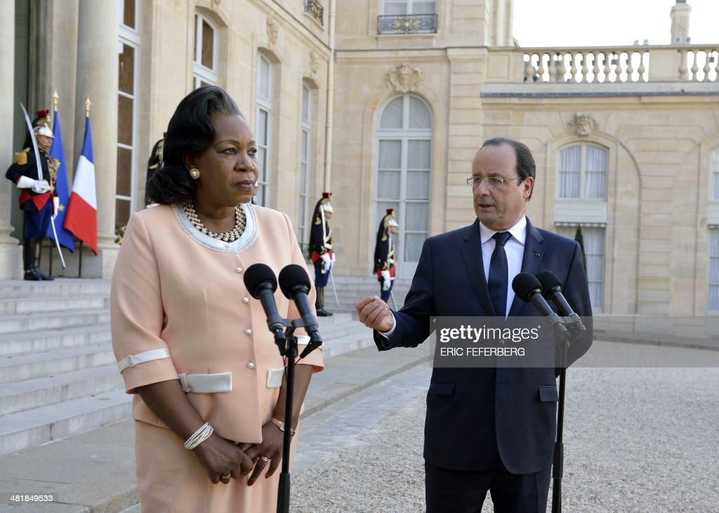French President Francois Hollande (R) speaks alongside Central African Republic President Catherine Samba-Panza on April 1, 2014, after a working meeting at the Elysee presidential palace in Paris. The UN's refugee agency said today it was prepared to help evacuate some 19,000 Muslims at risk of attack from mainly Christian militias in the conflict-torn Central African Republic.
