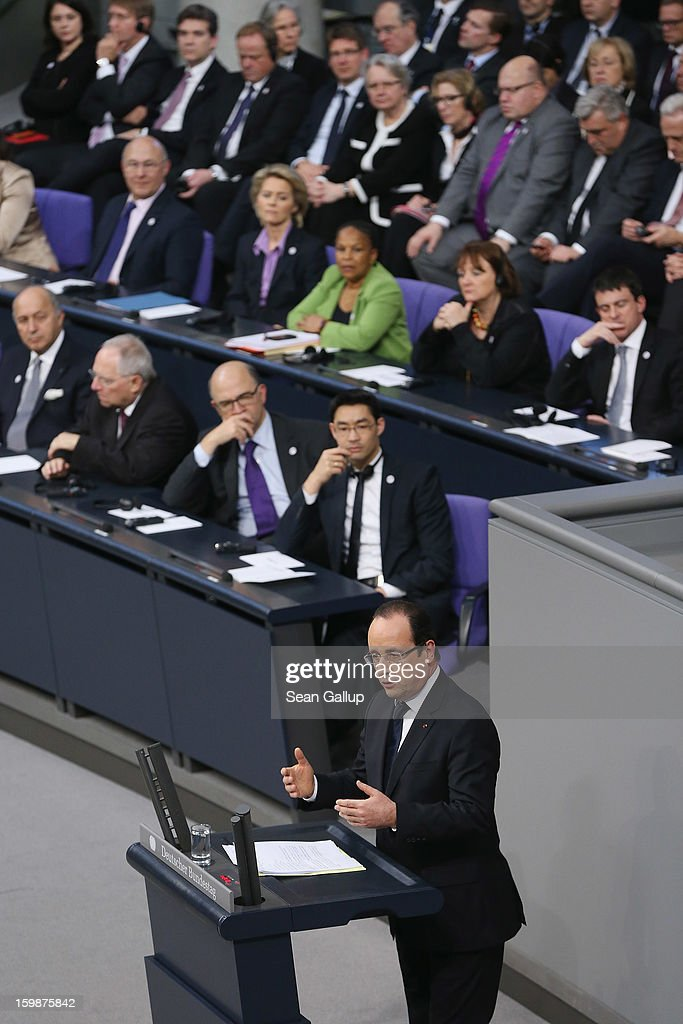 French President Francois Hollande speaks as members of the German and French governments look on during a joint session of the two governments at the Bundestag during the 50th anniversary celebration of the Elysee Treaty on January 22, 2013 in Berlin, Germany. The treaty, concluded in 1963 by Charles de Gaulle and Konrad Adenauer in the Elysee Palace in Paris, set a new tone of reconciliation between France and Germany, and called for consultations between the two countries to come to a common stance on policies affecting the most important partners in Europe as well as the rest of the region. Since its establishment, the document for improved bilateral relations has been seen by many as the driving force behind European integration.