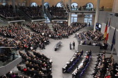 French President Francois Hollande speaks as members of the German Bundestag and French Assemble Nationale look on during a joint session of the two...
