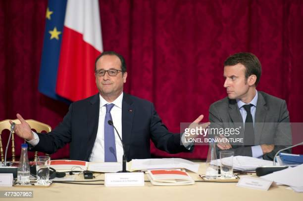 French President Francois Hollande speaks beside French Economy and Industry minister Emmanuel Macron during a strategic council on attractiveness at...