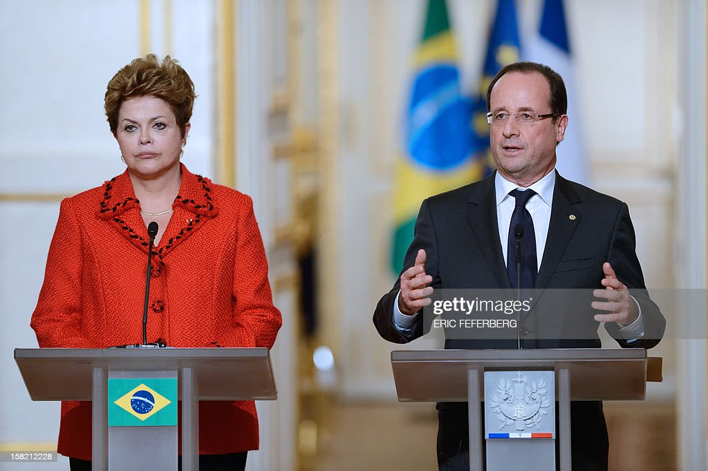French President Francois Hollande (R) speaks beside his Brazilian counterpart Dilma Rousseff, on December 11, 2012, during a joint press conference at the Elysee presidential palace in Paris. Brazilian President Dilma Rousseff kicked off her first official visit to France, where a decision on whether she will choose Rafale fighter jets or opt for another aircraft is keenly awaited. During the two-day trip Rousseff will have talks with French counterpart Francois Hollande on the eurozone crisis -- on which she has criticized EU austerity measures -- bilateral trade and wider matters of global concern. AFP PHOTO / ERIC FEFERBERG