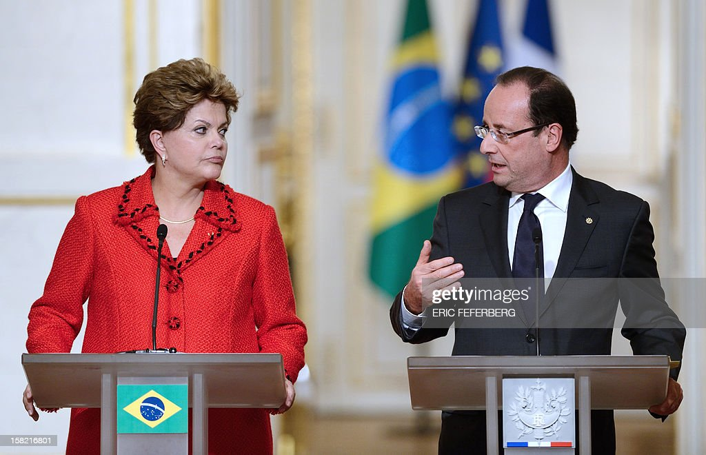 French President Francois Hollande (R) speaks beside his Brazilian counterpart Dilma Rousseff, on December 11, 2012, during a joint press conference at the Elysee presidential palace in Paris. Brazilian President Dilma Rousseff kicked off her first official visit to France, where a decision on whether she will choose Rafale fighter jets or opt for another aircraft is keenly awaited. During the two-day trip Rousseff will have talks with French counterpart Francois Hollande on the eurozone crisis -- on which she has criticized EU austerity measures -- bilateral trade and wider matters of global concern.
