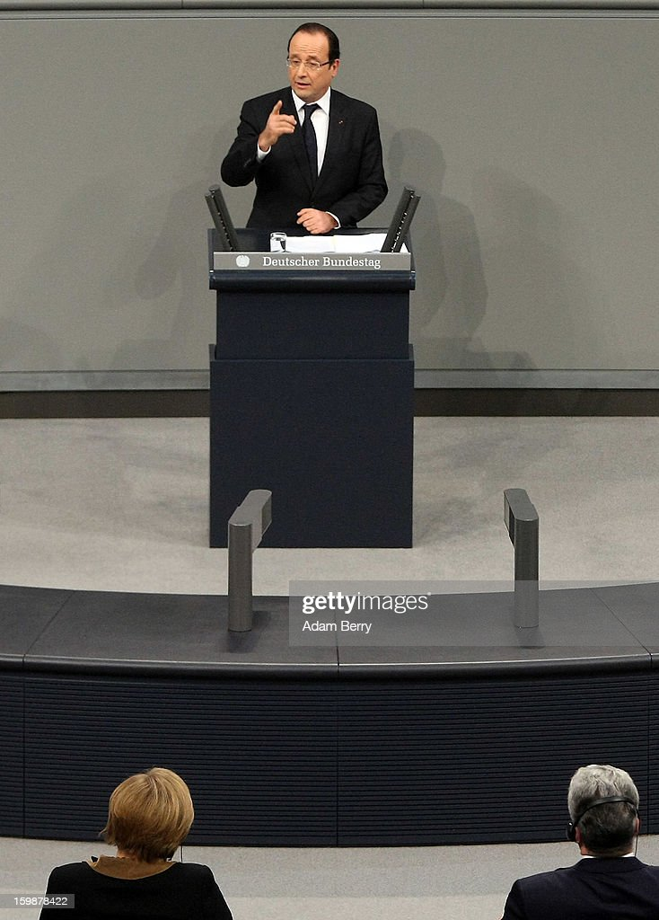 French President Francois Hollande speaks during a joint session of the German Bundestag and French Assemblee Nationale parliaments in the Reichstag building as German Chancellor Angela Merkel (L) and German President Joachim Gauck listen during the 50th anniversary celebration of the Elysee Treaty on January 22, 2013 in Berlin, Germany. The treaty, concluded in 1963 by Charles de Gaulle and Konrad Adenauer in the Elysee Palace in Paris, set a new tone of reconciliation between France and Germany, and called for consultations between the two countries to come to a common stance on policies affecting the most important partners in Europe as well as the rest of the region. Since its establishment, the document for improved bilateral relations has been seen by many as the driving force behind European integration.