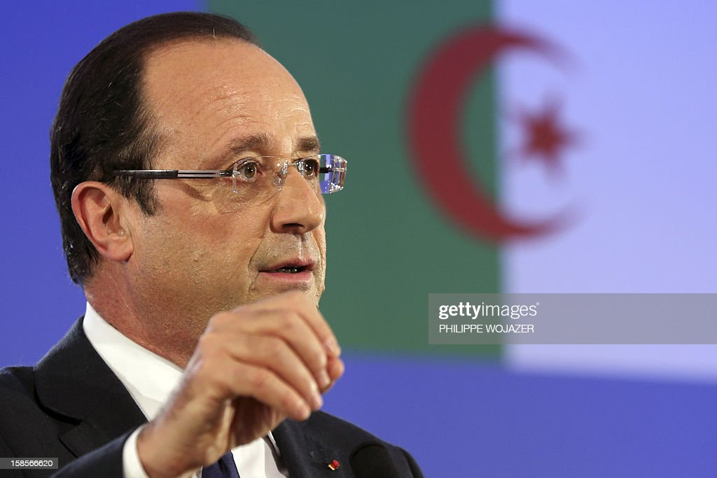 French President Francois Hollande speaks during a news conference in Algiers on December 19, 2012 as part of the first day of his state visit to Algeria. President Francois Hollande travels to Algeria on Wednesday to try to heal wounds left by a bloody war of independence half a century ago and to seek greater access to the former colony's oil wealth in an attempt to lift France's own flagging economy. AFP PHOTO POOL PHILIPPE WOJAZER
