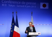French President Francois Hollande speaks during a press conference at Institut Francais du Japon in Tokyo on June 8 2013 Hollande was left redfaced...