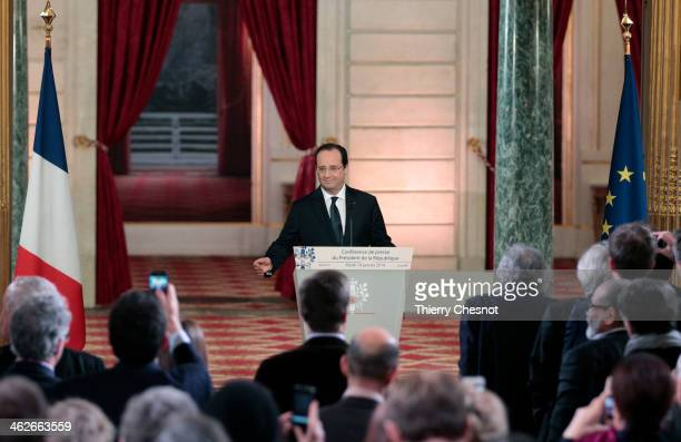 French president Francois Hollande speaks during a press conference to present his 2014 policy plans at the Elysee presidential palace on January 14...