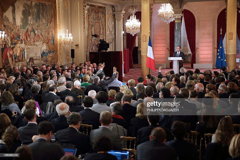 French President Francois Hollande (R) speaks during his first press conference at the Elysee Place in Paris on November 13, 2012. Hollande holds his first major press conference amid rising discontent over the flagging economy and a slump in his personal poll ratings.