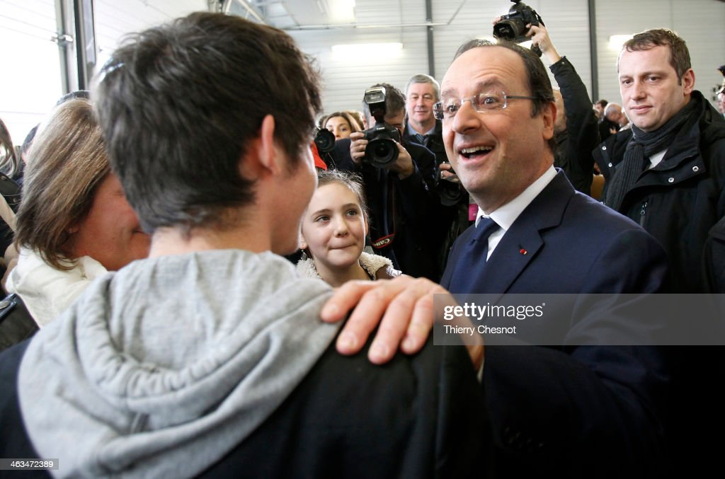 French President Francois Hollande speaks to a young boy during the opening of a fire and rescue department on January 18, in Tulle, France. Francois Hollande also visited the constituency of Correze, the department he headed before the presidential election, where he attended a New Year ceremony.