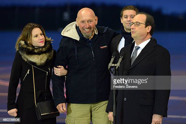 French President Francois Hollande speaks to the media and Welcomes former hostage Serge Lazarevic with daughter Diane and Clement Verdon son of...