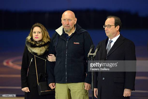 French President Francois Hollande speaks to the media and Welcomes former hostage Serge Lazarevic as he stands with daughter Diane after he returns...