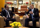 French President Francois Hollande speaks with Australia's Prime Minister Tony Abbott at Parliament House in Canberra on November 19 2014 Hollande is...