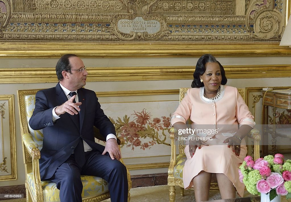 French President Francois Hollande (L) speaks with Central African Republic President Catherine Samba-Panza on April 1, 2014, during a working meeting at the Elysee presidential palace in Paris. The UN's refugee agency said today it was prepared to help evacuate some 19,000 Muslims at risk of attack from mainly Christian militias in the conflict-torn Central African Republic.