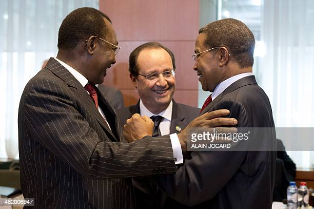 French President Francois Hollande speaks with Chadian President Idriss Deby Itno and Tanzania President Jakaya Kikwete during the 4th EUAfrica...
