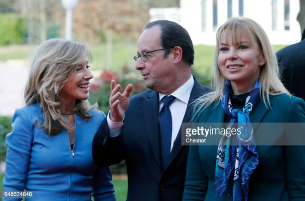 French President Francois Hollande speaks with Disneyland Paris President Catherine Powell and European Commissioner for Internal Market Elzbieta...