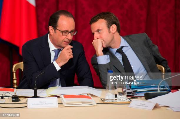 French President Francois Hollande speaks with French Economy and Industry minister Emmanuel Macron during a strategic council on attractiveness at...
