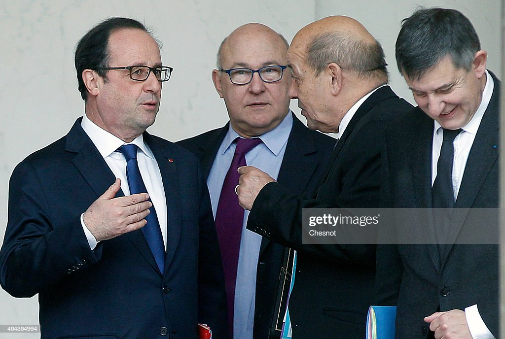 French President Francois Hollande speaks with French Finance Minister <a gi-track='captionPersonalityLinkClicked' href=/galleries/search?phrase=Michel+Sapin&family=editorial&specificpeople=668944 ng-click='$event.stopPropagation()'>Michel Sapin</a>, French Defence Minister <a gi-track='captionPersonalityLinkClicked' href=/galleries/search?phrase=Jean-Yves+Le+Drian&family=editorial&specificpeople=2122785 ng-click='$event.stopPropagation()'>Jean-Yves Le Drian</a> and French presidential chief of staff <a gi-track='captionPersonalityLinkClicked' href=/galleries/search?phrase=Jean-Pierre+Jouyet&family=editorial&specificpeople=2521501 ng-click='$event.stopPropagation()'>Jean-Pierre Jouyet</a> as they leave the weekly cabinet meeting at the Elysee presidential Palace, on February 25, 2015 in Paris, France.